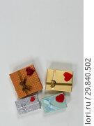 Купить «Valentine gifts and decorations on white background», фото № 29840502, снято 11 октября 2018 г. (c) Wavebreak Media / Фотобанк Лори