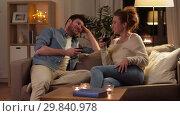 Купить «happy couple drinking red wine at home in evening», видеоролик № 29840978, снято 27 января 2019 г. (c) Syda Productions / Фотобанк Лори