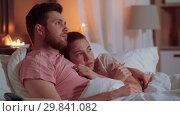 Купить «couple watching horror on tv in bed at night», видеоролик № 29841082, снято 27 января 2019 г. (c) Syda Productions / Фотобанк Лори