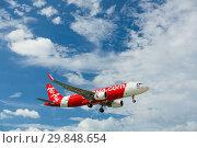 Купить «Airbus AirAsia flying overhead», фото № 29848654, снято 27 ноября 2016 г. (c) Игорь Жоров / Фотобанк Лори
