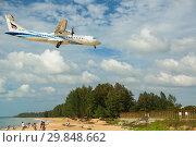 Купить «Plane over the beach», фото № 29848662, снято 27 ноября 2016 г. (c) Игорь Жоров / Фотобанк Лори