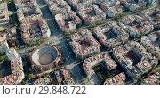 Купить «Aerial view of Barcelona cityscape with peculiar geometric grid of Eixample district», видеоролик № 29848722, снято 16 ноября 2018 г. (c) Яков Филимонов / Фотобанк Лори