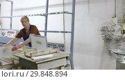 Купить «woman and her male colleague working at glass factory», видеоролик № 29848894, снято 16 октября 2018 г. (c) Яков Филимонов / Фотобанк Лори
