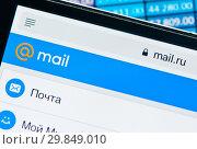 Купить «Фрагмент страницы Mail.Ru на экране мобильного телефона на фоне столбиков с числами», фото № 29849010, снято 1 февраля 2019 г. (c) E. O. / Фотобанк Лори
