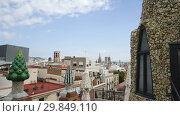 Купить «Fantastic shapes fo chimneys and central spire on roof of Guell Palace by Antoni Gaudi», видеоролик № 29849110, снято 2 сентября 2018 г. (c) Яков Филимонов / Фотобанк Лори