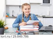 Купить «Happy girl sitting among notebooks», фото № 29849786, снято 27 сентября 2018 г. (c) Яков Филимонов / Фотобанк Лори
