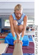 Купить «Happy beautiful woman gymnast training gymnastic action at broad bars», фото № 29849962, снято 18 июля 2018 г. (c) Яков Филимонов / Фотобанк Лори