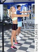 Купить «couple during common weightlifting workout», фото № 29849978, снято 16 июля 2018 г. (c) Яков Филимонов / Фотобанк Лори