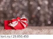 Купить «Bright open Christmas gift box in snow on a gray background», фото № 29850450, снято 15 ноября 2018 г. (c) Сергей Молодиков / Фотобанк Лори