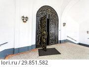 Купить «Black metal gate with decorative iron patterns golden colors», фото № 29851582, снято 10 июня 2018 г. (c) FotograFF / Фотобанк Лори