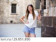 Купить «Young woman resting against old stone wall», фото № 29851890, снято 15 августа 2017 г. (c) Яков Филимонов / Фотобанк Лори