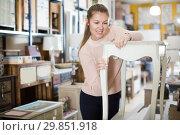 Купить «woman buyer standing near nightstand», фото № 29851918, снято 15 ноября 2017 г. (c) Яков Филимонов / Фотобанк Лори