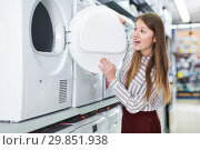Купить «Woman choosing washing machine in household appliances shop», фото № 29851938, снято 12 декабря 2017 г. (c) Яков Филимонов / Фотобанк Лори