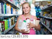 Купить «Cheerful girl holding shampoo and shower gel», фото № 29851970, снято 5 августа 2017 г. (c) Яков Филимонов / Фотобанк Лори