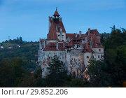 Купить «Bran Castle on cliff top on twilight», фото № 29852206, снято 18 сентября 2017 г. (c) Яков Филимонов / Фотобанк Лори