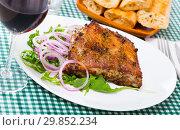 Купить «Grilled rack of pork with arugula and onion», фото № 29852234, снято 23 марта 2019 г. (c) Яков Филимонов / Фотобанк Лори