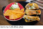 Купить «Mexican tacos with guacamole and nachos», фото № 29852262, снято 19 марта 2019 г. (c) Яков Филимонов / Фотобанк Лори