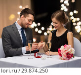 Купить «man giving woman engagement ring at restaurant», фото № 29874250, снято 9 марта 2014 г. (c) Syda Productions / Фотобанк Лори