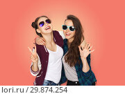 Купить «smiling teenage girls in sunglasses showing peace», фото № 29874254, снято 19 декабря 2015 г. (c) Syda Productions / Фотобанк Лори