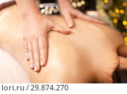 Купить «woman lying and having back massage at spa», фото № 29874270, снято 26 января 2017 г. (c) Syda Productions / Фотобанк Лори