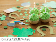 Купить «green cupcakes and st patricks day party props», фото № 29874426, снято 31 января 2018 г. (c) Syda Productions / Фотобанк Лори