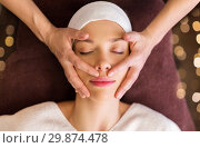 Купить «woman having face and head massage at spa», фото № 29874478, снято 26 января 2017 г. (c) Syda Productions / Фотобанк Лори