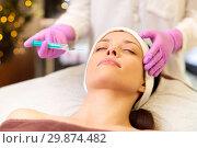 Купить «beautician doing beauty injection to woman lips», фото № 29874482, снято 26 января 2017 г. (c) Syda Productions / Фотобанк Лори