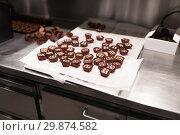 Купить «chocolate candies at confectionery shop», фото № 29874582, снято 4 декабря 2018 г. (c) Syda Productions / Фотобанк Лори