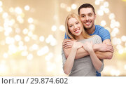 Купить «smiling couple hugging over festive lights», фото № 29874602, снято 9 февраля 2014 г. (c) Syda Productions / Фотобанк Лори