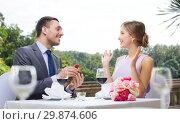 Купить «man giving woman engagement ring at restaurant», фото № 29874606, снято 9 марта 2014 г. (c) Syda Productions / Фотобанк Лори