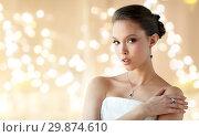 Купить «beautiful woman with earring, ring and pendant», фото № 29874610, снято 9 апреля 2016 г. (c) Syda Productions / Фотобанк Лори