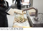 Купить «confectioner makes chocolate candies at sweet-shop», фото № 29874658, снято 4 декабря 2018 г. (c) Syda Productions / Фотобанк Лори