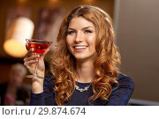 woman with glass of cocktail at night club. Стоковое фото, фотограф Syda Productions / Фотобанк Лори