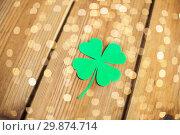 Купить «green paper four-leaf clover on wooden background», фото № 29874714, снято 31 января 2018 г. (c) Syda Productions / Фотобанк Лори