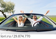 Купить «happy man and woman driving in cabriolet car», фото № 29874770, снято 15 июля 2015 г. (c) Syda Productions / Фотобанк Лори