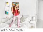 Купить «happy woman in headphones having fun at home», фото № 29874802, снято 14 ноября 2015 г. (c) Syda Productions / Фотобанк Лори