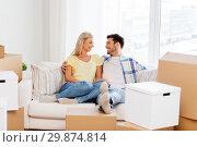 Купить «happy couple with boxes moving to new home», фото № 29874814, снято 25 февраля 2016 г. (c) Syda Productions / Фотобанк Лори