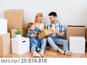 Купить «happy family with boxes moving to new home», фото № 29874818, снято 25 февраля 2016 г. (c) Syda Productions / Фотобанк Лори
