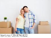 Купить «happy couple with boxes moving to new home», фото № 29874822, снято 25 февраля 2016 г. (c) Syda Productions / Фотобанк Лори