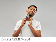 Купить «smiling indian man shaving beard with trimmer», фото № 29874954, снято 27 октября 2018 г. (c) Syda Productions / Фотобанк Лори