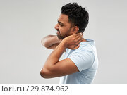 Купить «unhealthy indian man suffering from neck pain», фото № 29874962, снято 27 октября 2018 г. (c) Syda Productions / Фотобанк Лори