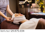 Купить «woman having face massage with towel at spa parlor», фото № 29875034, снято 26 января 2017 г. (c) Syda Productions / Фотобанк Лори