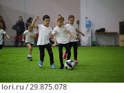 Купить «Children playing football indoors. Children lead the ball», фото № 29875078, снято 30 января 2019 г. (c) Константин Шишкин / Фотобанк Лори