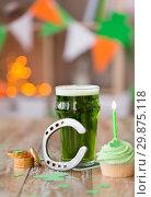 Купить «glass of beer, cupcake, horseshoe and gold coins», фото № 29875118, снято 31 января 2018 г. (c) Syda Productions / Фотобанк Лори