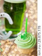 Купить «green cupcake with candle, beer and horseshoe», фото № 29875178, снято 31 января 2018 г. (c) Syda Productions / Фотобанк Лори
