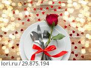 Купить «close up of red rose flower on set of dishes», фото № 29875194, снято 9 февраля 2018 г. (c) Syda Productions / Фотобанк Лори