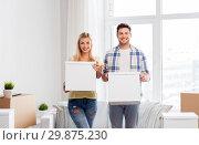 Купить «happy couple with boxes moving to new home», фото № 29875230, снято 25 февраля 2016 г. (c) Syda Productions / Фотобанк Лори
