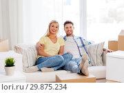 Купить «happy couple with boxes moving to new home», фото № 29875234, снято 25 февраля 2016 г. (c) Syda Productions / Фотобанк Лори
