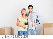 Купить «couple with flower and lamp moving to new home», фото № 29875238, снято 25 февраля 2016 г. (c) Syda Productions / Фотобанк Лори