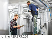 Купить «men with clipboard at brewery kettle or beer plant», фото № 29875266, снято 24 марта 2017 г. (c) Syda Productions / Фотобанк Лори